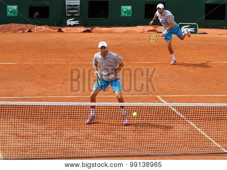 Grand Slam champions Mike and Bob Bryan of United States in action during match at Roland Garros