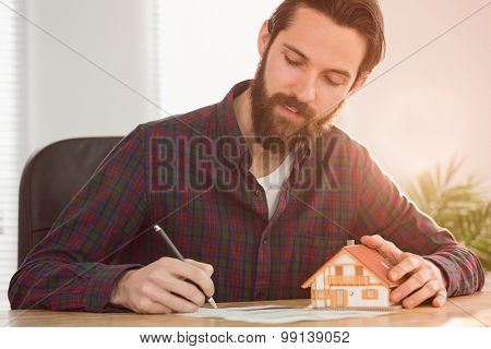 Hipster businessman applying for a mortgage in his office