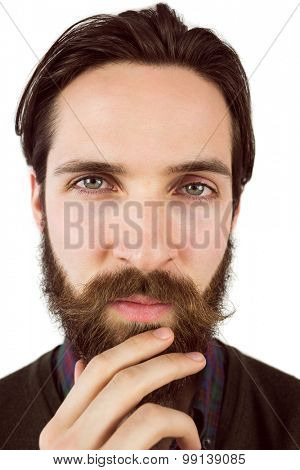 Hipster thinking with hand on chin on white background