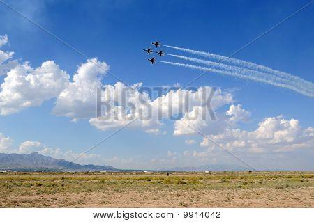 USAF Thunderbirds in Formation Over Desert