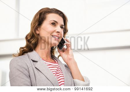 Casual businesswoman having a phone call in the office