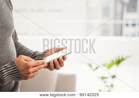 Close up view of hands using smartphone in the office