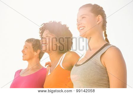 Smiling sporty women looking far away at promenade