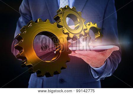 Businessman using tablet pc against blue background with vignette