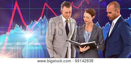 Businesswoman showing her notes to her colleagues against stocks and shares