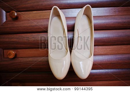 Beige Bridal Shoes On Wooden Background
