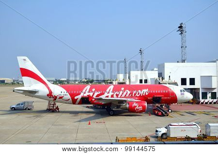 Air Asia Aircraft Waiting For Passenger And Baggage Loading.