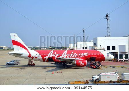 Air Asia Aircraft Waiting For Passenger And Baggage Loading.