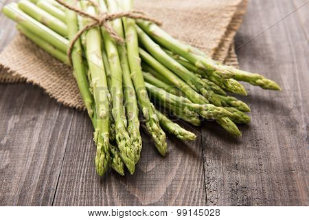 Bunch Of Fresh Green Asparagus On A Rustic Wooden Table