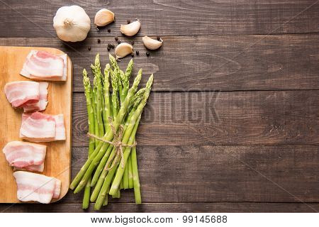 Smoked Bacon With Fresh Asparagus On Wooden Background