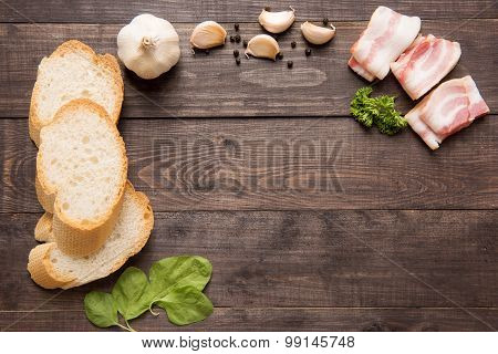 Ingredients for sandwich on wooden background