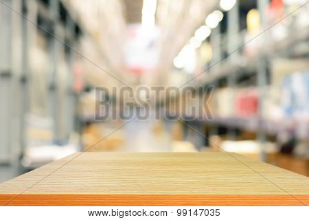 Empty Wood Table Top Or Shelf On Blurred Warehouse Background