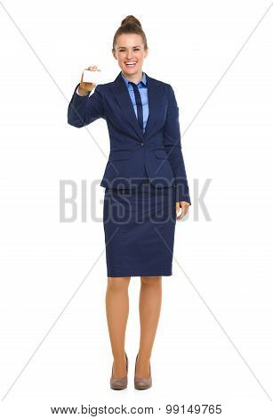 Smiling Businesswoman In Blue Suit Holding Up Business Card
