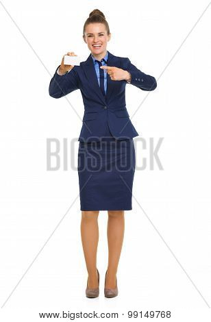 Smiling Businesswoman Pointing To Business Card