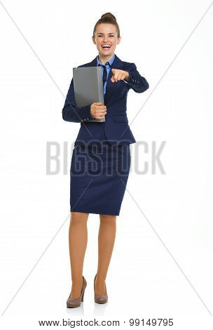 Happy Businesswoman Holding File And Pointing Directly At Camera