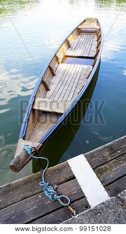 Wood Boat In The Lake And Pier