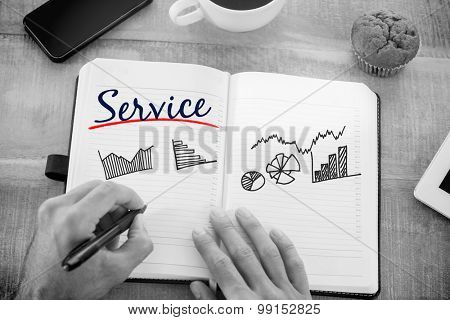 The word service and man writing notes on diary against business graphs
