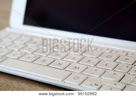 Detail Of Tablet With Modern White Keyboard