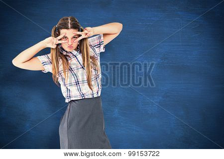 Geeky hipster dancing against blue chalkboard