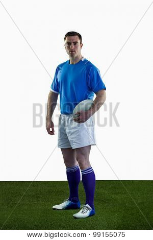 Portrait of a standing rugby player holding a rugby ball
