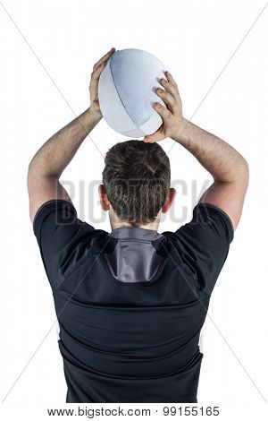 Back turned rugby player throwing a ball on a white background
