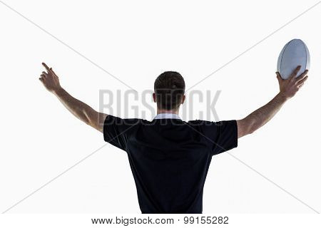 Rugby player gesturing with hands and holding a rugby ball