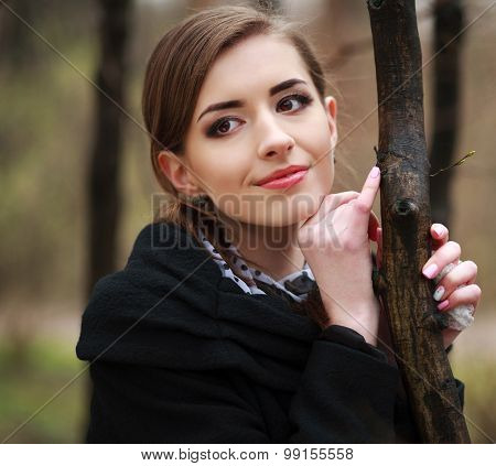 Dreamy Young Woman In A Black Coat In The Autumn Park