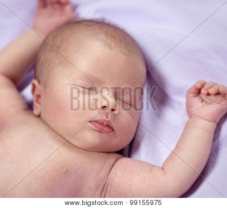 newborn little child baby sleeping sweet lying down eyes closed face