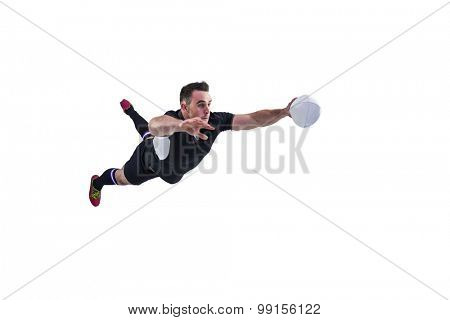 Rugby player scoring a try on white background