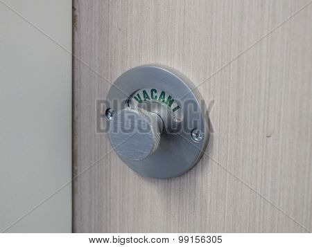 Lock of a shower cubicle indicating green Vacant position