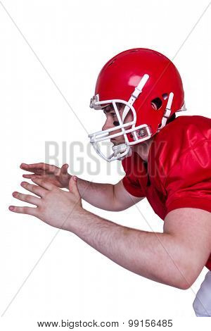Profile view of an american football player about to catch a ball