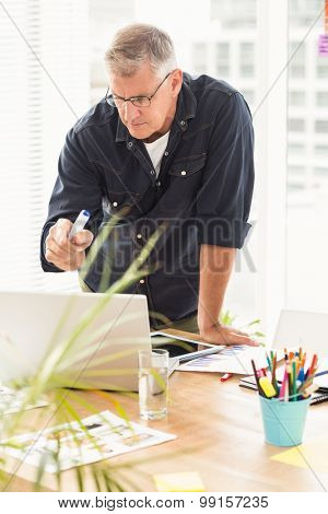 Attentive businessman working on a laptop at the office
