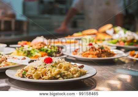 Food orders on the kitchen table in the restaurant