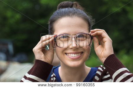 Young Woman With Old Style Dusty Glasses