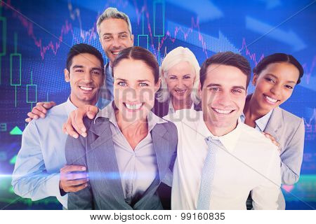 Happy business people looking at camera against stocks and shares