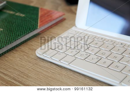 Tablet With Paper Block On The Table