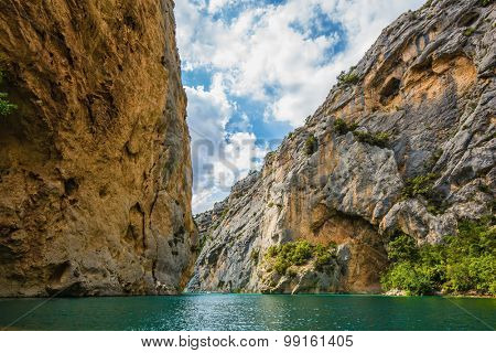 Mercantour National Park, Provence. The rocky slopes of canyon Verdon descend into azure water of the river