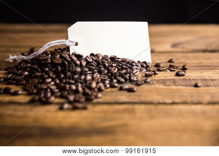 Coffee beans on a table with tag shot in studio