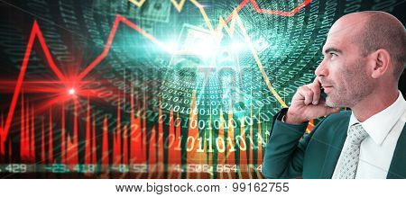 businessman calling on the phone against stocks and shares