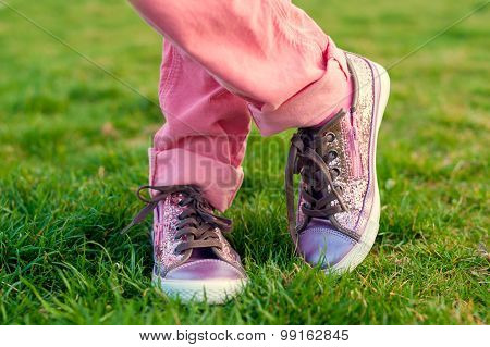 Close up of shiny  tennis shoes on child's feet