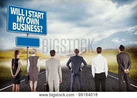 Business team against blue sign by road