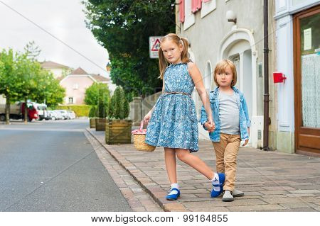 Portrait of fashion kids in a city, cute kids posing outdoors