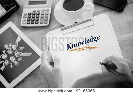 The word knowledge and man writing on clipboard on working desk against hands holding phones