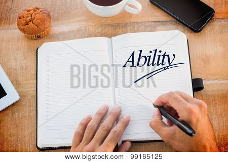 The word ability against man writing notes on diary