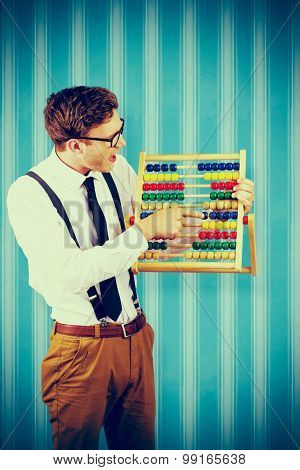 Geeky businessman using an abacus against blue background