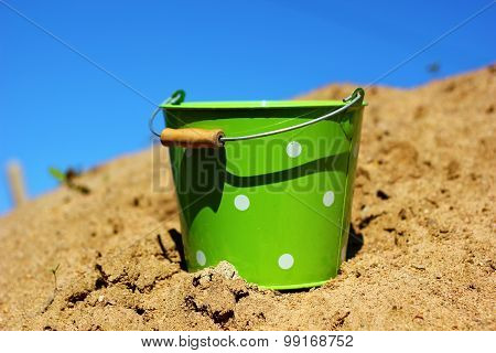 yellow sand and a bucket