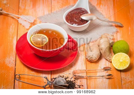 Cup Of  Tea With Ginger,   Raspberry Jam And Lemon