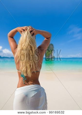 Beautiful woman on the beach in Thailand Winter holidays in the sun