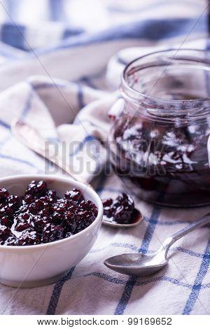 Blackberry jam jar over linen napkin