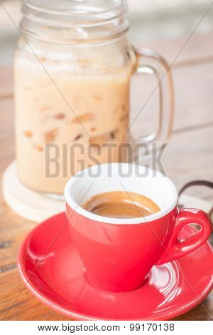 Hot And Cold Coffee On Wooden Table